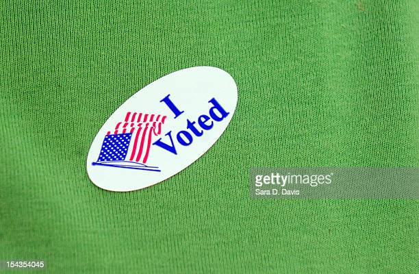 A voter displays their I Voted sticker on their shirt after voting on the first day of Early Voting on October 18 2012 in Wilson North Carolina Early...