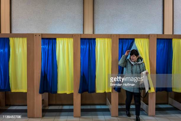A voter emerges from the voting booth after filling out her ballot for Ukraine's presidential election on March 31 2019 in Kiev Ukraine If no...