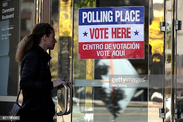 A voter enters a polling place on Election Day November 8 2016 in Arlington Virginia Americans across the nation pick their choice for the next...
