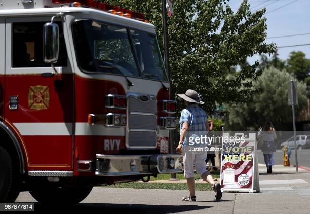 A voter enters a polling station at a Ross Valley fire station on June 5 2018 in San Anselmo California California voters are heading to the polls to...