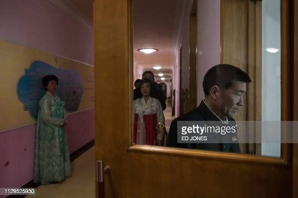 A voter enters a room to cast their ballot at a voting centre at the 'Pyonyang number four Primary School' during voting for the Supreme People's...