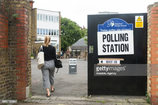 Voter enters Pakeman primary school polling station to vote in the General Election in London, United Kingdom on June 08, 2017.