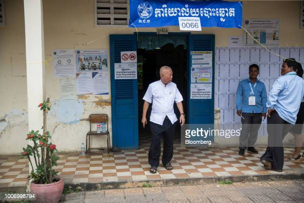 A voter exits a polling station after casting his ballot for the general election in Phnom Penh Cambodia on Sunday July 29 2018 As Cambodians vote on...