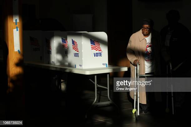 A voter exits after casting her ballot at a polling place at Highland Colony Baptist Church November 27 2018 in Ridgeland Mississippi Voters in...