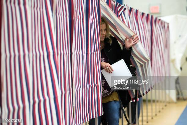 A voter exits the voting booth after filling out their ballot at the Broken Ground School during the presidential primary on February 11 2020 in...