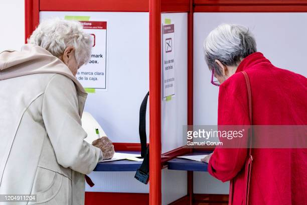 Voter fill out their ballots during the Democratic presidential primary elections at the McKinley Elementary School polling location on Super Tuesday...