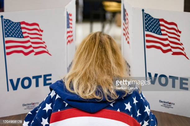 A voter fills in her ballots for the Democratic presidential primary election at a polling place in Armstrong Elementary School on Super Tuesday...