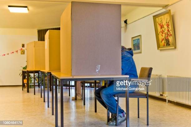A voter fills in his ballot paper in a polling station in Hesse state elections on October 28 2018 in Giessen Germany Polls so far indicate that the...