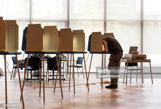 A voter fills out a ballot for the 2018 Minnesota primary election polling place inside the Westminster Presbyterian Church on August 14 2018 in...