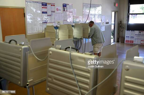 A voter fills out a ballot inside a polling station at a Ross Valley fire station on June 5 2018 in San Anselmo California California voters are...