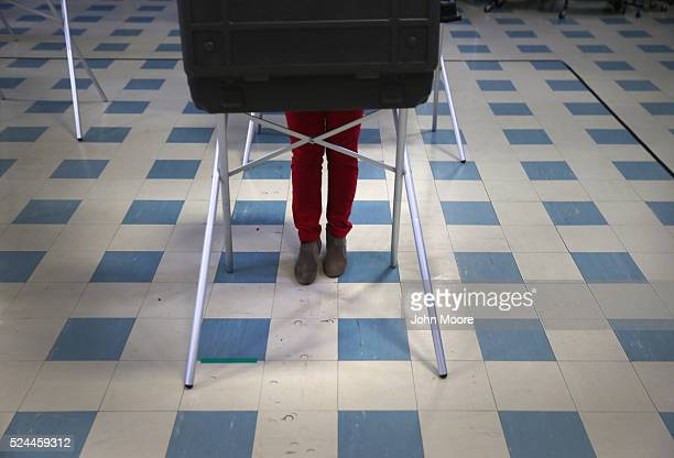 A voter fills out her ballot at a polling center on April 26 2016 in Stamford Connecticut Democratic and Republican primary voters across five...