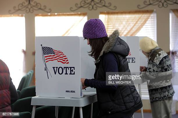 A voter fills out her ballot at a polling station in the Summit Christian Fellowship in Big Bear California November 8 2016 / AFP / Bill Wechter