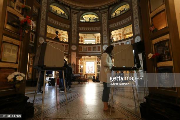 A voter fills out her ballot in a polling station at the San Francisco Columbarium Funeral Home on March 03 2020 in San Francisco California 1357...