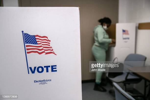 Voter fills out her ballot on the last day of early voting at the Lansing City Clerk's office on November 02, 2020 in Lansing, Michigan. In 2016 U.S....