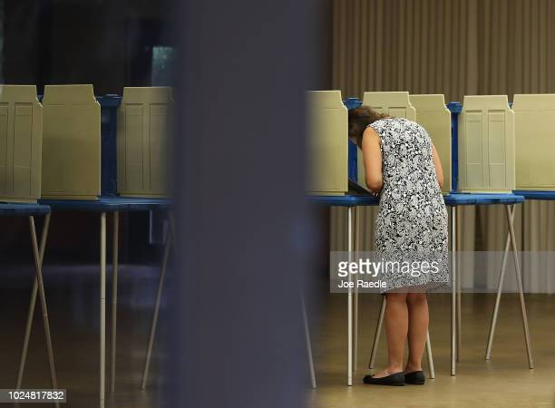 A voter fills out her primary day voting ballot at a polling station on August 28 2018 in St Augustine Florida Republican Gov Rick Scott is vacating...