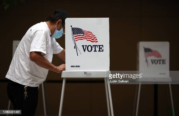 Voter fills out his ballot while early voting at the Santa Clara County registrar of voters office on October 13, 2020 in San Jose, California. The...