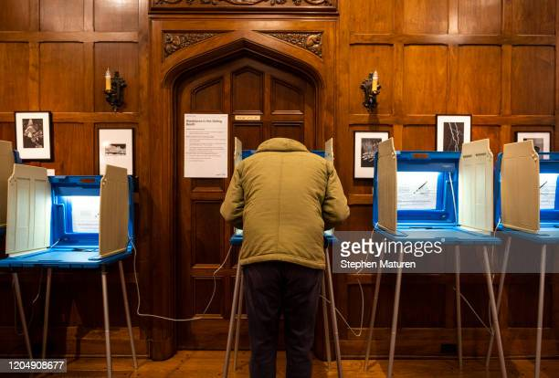 A voter fills out their ballot at a polling place in the Bakken Museum on March 3 2020 in Minneapolis Minnesota 1357 Democratic delegates are at...