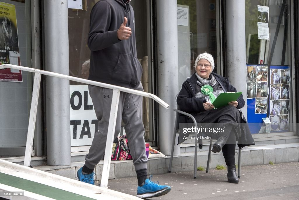 A voter gestures as a Green Party supporter counts voters at a Polling station in the Phil Martin Centre in Moss Side on May 3, 2018 in Manchester, England. Voters are heading to the polls today for council and mayoral elections across England.
