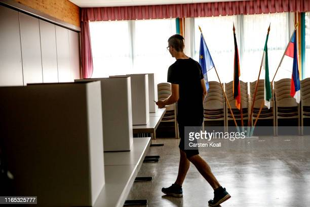 A voter goes to a polling booth in a polling station in Saxony on September 1 2019 in Crostwitz near Dresden Germany Saxony and the neighboring state...