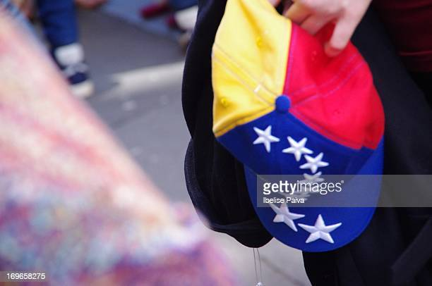 Voter holding baseball cap with Venezuela flag colors wait for its turn to vote at the Venezuelan presidential elections. Venezuela's embassy in...