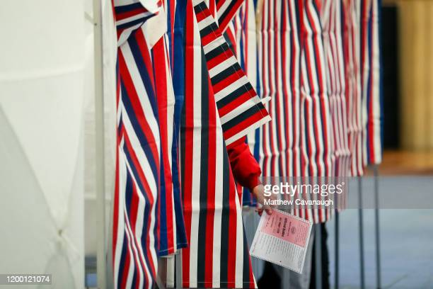 A voter holds their ballot after voting at Bedford High School during the New Hampshire primary on February 11 2020 in Bedford New Hampshire