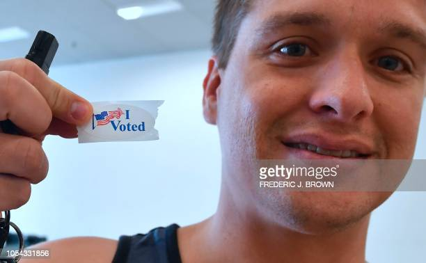 Voter Joel Buffington displays his I Voted sticker after dropping off his ballot at an Early Vote Center in Huntington Beach California on October 27...