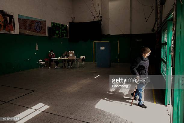 A voter leaves a polling station after casting her vote for president in Buenos Aires Argentina on Sunday Oct 25 2015 Argentina is moving a step...