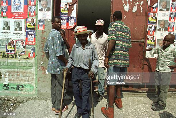 A voter leaves a polling station after voting in PortauPrince Haiti May 21 2000 Voters waited for as long as 5 hours to cast their ballot amidst...