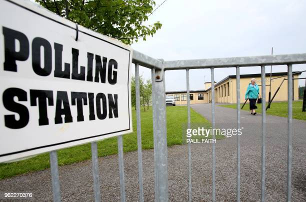 A voter leaves a polling to station after where people can vote in the Irish abortion referendum in Knock northwest Ireland on May 25 2018 Irish...