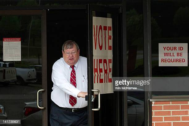 Voter leaves the First Baptist Church Pelham Annex after casting his ballot in the Republican Presidential Primary March 13, 2012 in Pelham, Alabama....