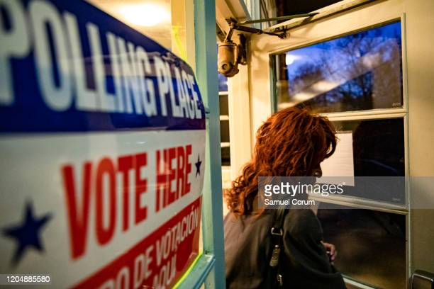 A voter leaves the Madison Community Center polling place after casting her ballot in the Democratic presidential primary on Super Tuesday on March 3...