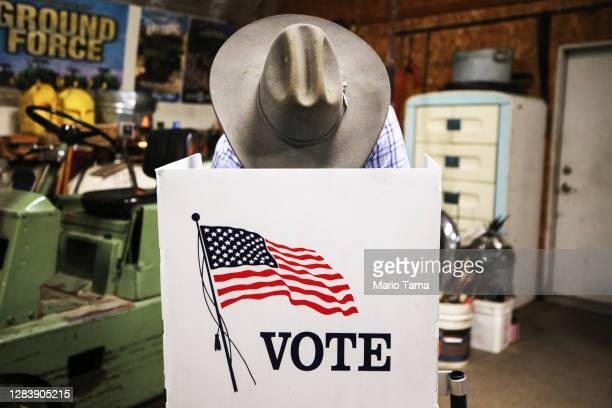 Voter marks his ballot at a polling place in Dennis Wilkening's shed on November 3, 2020 in Richland, Iowa. After a record-breaking early voting...