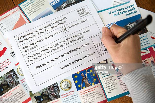 A voter marks the box to 'Leave the European Union' on an EU referendum postal ballot slip in this arranged photograph in London UK on Wednesday June...