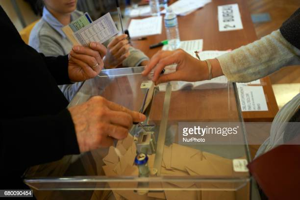 A voter oputs his ballot in the urn Counting of the ballots on the 2nd round of the French presidential election Emmanuel Macron is elected President...