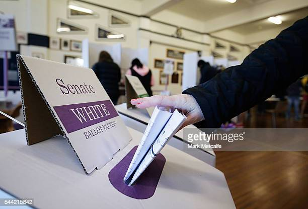 A voter places a ballot paper in a ballot box at Bondi Surf Bathers' Life Saving Club in the electorate of Wentworth on July 2 2016 in Sydney...