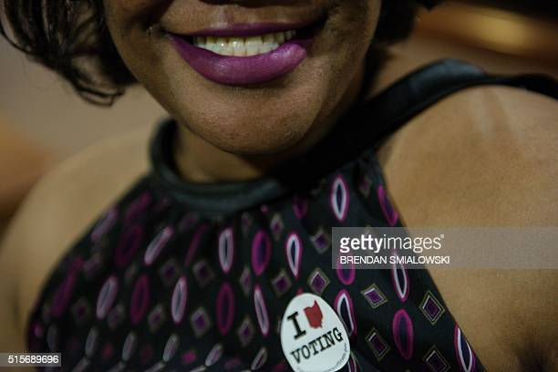 A voter poses with a sticker during primary voting in Stark County March 15 2016 in Canton Ohio / AFP / Brendan Smialowski