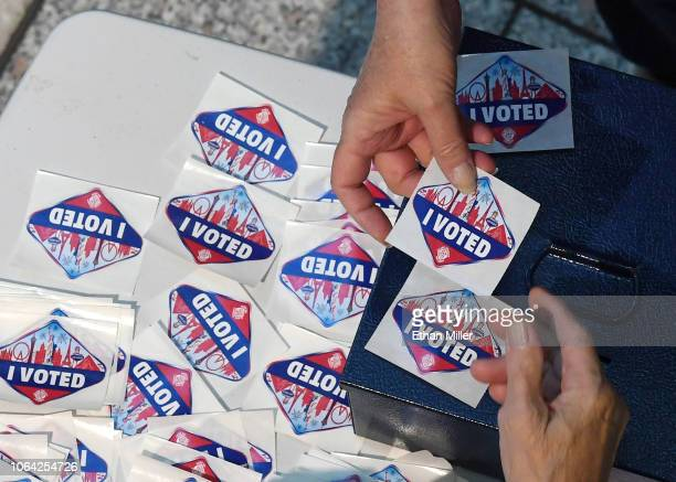 A voter receives a Las Vegas Stripthemed I Voted sticker after voting at the Galleria at Sunset mall on November 6 2018 in Henderson Nevada Americans...