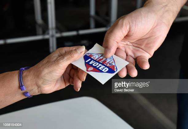 A voter receives a Las Vegas Stripthemed I Voted stickers after voting on November 6 2018 in Las Vegas Nevada Turnout is expected to be high...