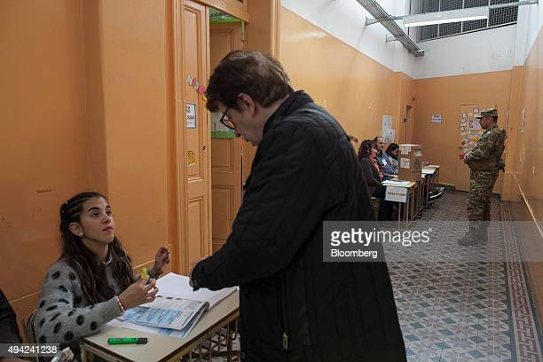 A voter registers to vote for president at a polling station in Buenos Aires Argentina on Sunday Oct 25 2015 Argentina is moving a step closer toward...
