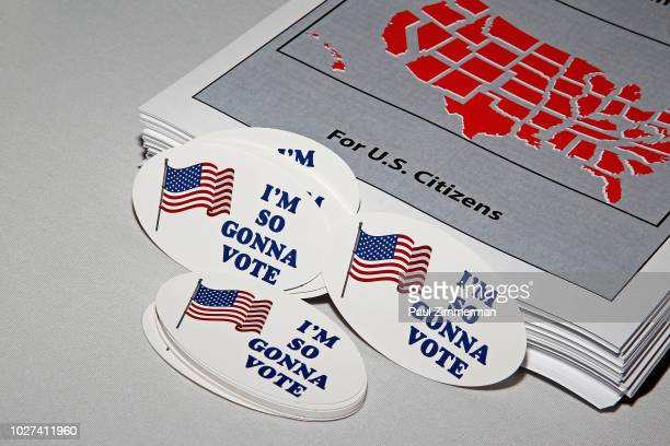 Voter registration forms and stickers available during the Full Frontal With Samantha Bee Presents This Is Not A Game The Game press junket on...