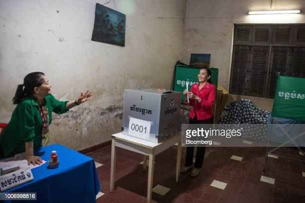 A voter right casts her ballot for the general election at a polling station in Phnom Penh Cambodia on Sunday July 29 2018 As Cambodians vote on...