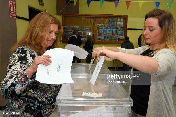 A voter seen casting her vote at a polling station during the Spanish general elections in El Vendrell Tarragona Catalonia