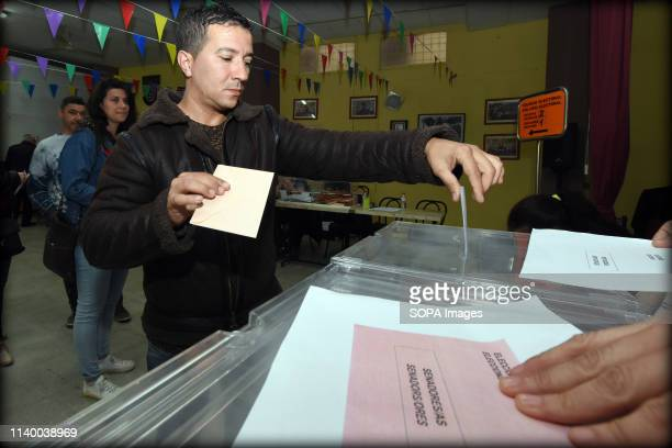 A voter seen casting his vote at a polling station during the Spanish general elections in El Vendrell Tarragona Catalonia