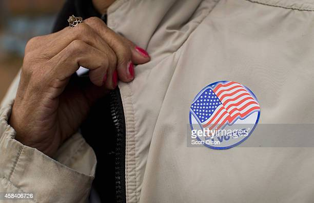 A voter shows off her I Voted sticker as she leaves a polling place on November 4 2014 in Ferguson Missouri In last Aprils election only 1484 of...