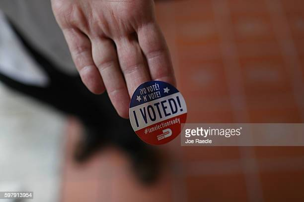 A voter shows off his 'I Voted' sticker after voting in the Florida primary on August 30 2016 in Miami Florida There are Senate seats as well as...