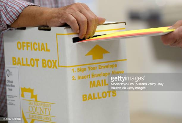 A voter submits his mail ballot as residents vote in the midterm elections at the Contemporary Club in Redlands on Tuesday November 6 2018