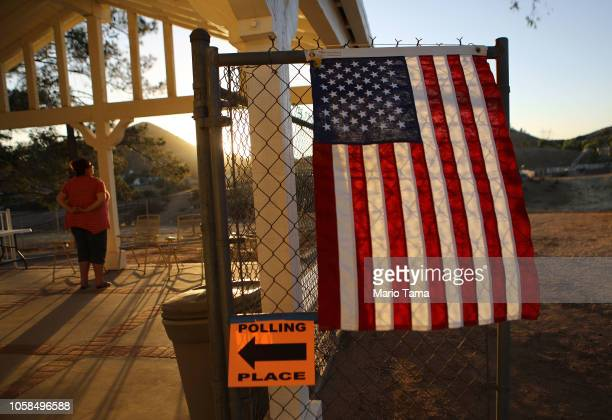 A voter takes in the view outside a polling place after casting her ballot in California's 25th Congressional district on November 6 2018 in Agua...