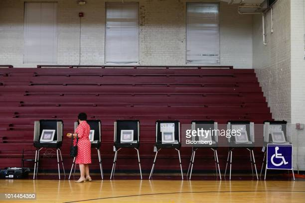 A voter uses an electronic voting machine to cast a ballot during the Georgia primary runoff elections in Atlanta Georgia US on Tuesday July 24 2018...