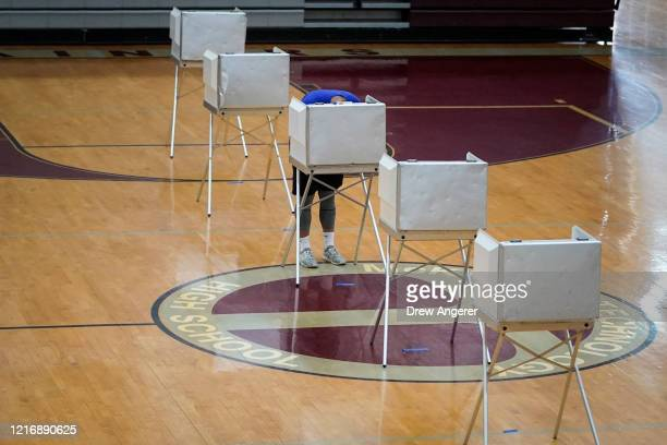A voter votes at McKinley Technology High School on primary election day on June 2 2020 in Washington DC On Tuesday nine states and the District of...