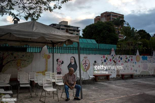 A voter waits outside a polling station during a nationwide mayoral election in Caracas Venezuela on Sunday Dec 10 2017 Major opposition parties...